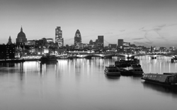 Employee benefits - picture of city of London at night with river and reflections